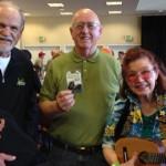 Ukes of Paradise raffle winners Alan (Kala ukulele); Paul (tuner) and Shirley (custom ukulele and tuner!).